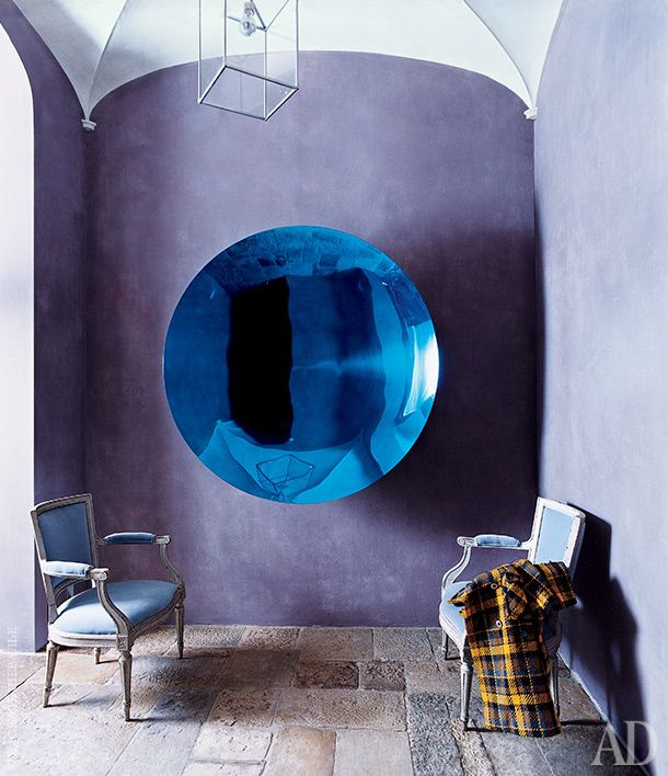 Purple and blue - the colors of the main hallway. Two French antique chairs upholstered by Designers Guild. Wall sculpture by Anish Kapoor (2002) bought in the Lisson Gallery in London.