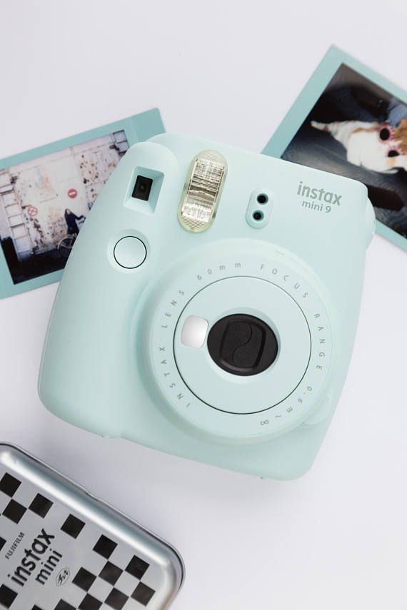 Cute and compact Instax Mini 9 instant photo camera. Instant photos - instant fun!  Picture size: 62 x 46mm Shooting range / Focusing range: 0.6m - ∞ Power Supply: Two LR6/AA-size 1.5V alkaline batteries Capacity: 10 film packs Dimensions & Weight 116mm x 118.3mm x 68.2mm / 307g (without batteries, strap and film pack)  _____  Now available with Instax mini film.  _____  Treat your new camera: Protective pouch for Instax Mini 9 - http://etsy.me/2iGNjfx Elegan...