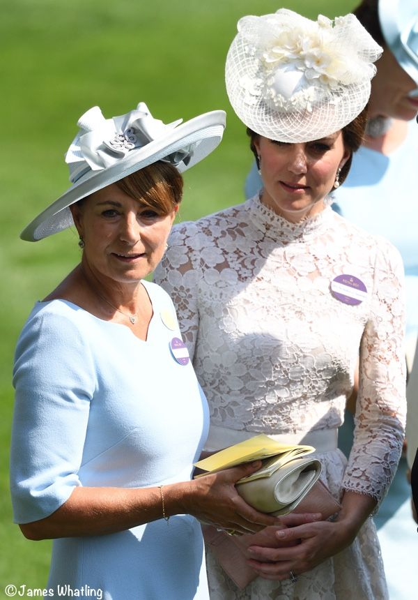 Kate with her mother, Carole Middleton, who is wearing Goat Fashion's 'Devon' dress in pacific blue. Several savvy fashion followers point out she is wearing the same hat worn to Kate & William's wedding.