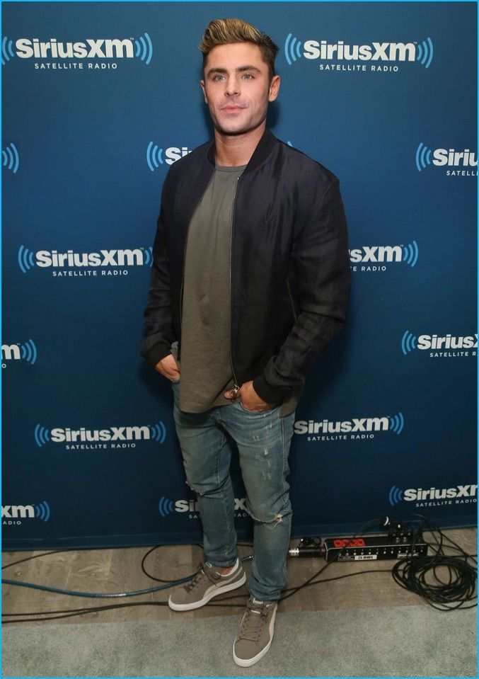 May 2016: Zac Efron goes casual as he steps out for SiriusXM's Town Hall with the cast of Neighbors 2 in New York City.