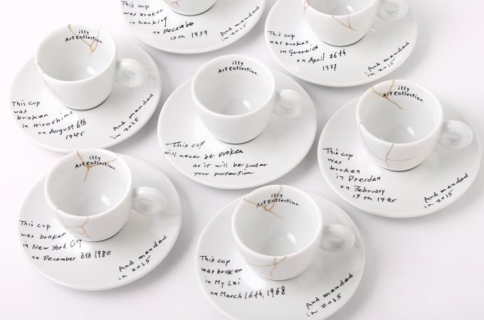 """Yoko Ono is expressing herself through espresso cups .....a collection of cups and saucers featuring the dates and places of six tragic events written in Ono's handwriting, such as the atomic bombing of Hiroshima in 1945 and the day Lennon was shot and killed in 1980. A seventh cup appears untouched to represent hope. The collection is titled """"Yoko Ono: Mended Cups – illy Art Collection"""""""