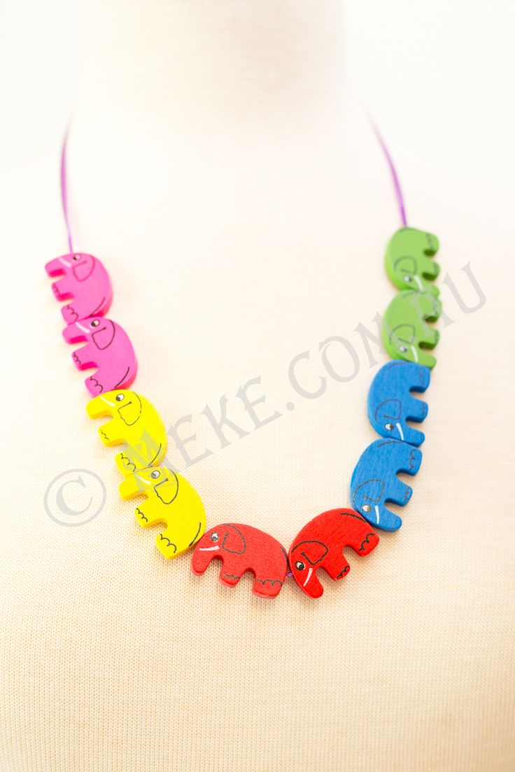 : : Noah's Elephant Ark Necklace : :  Bright rainbow coloured elephants parade in pairs along this fun handcrafted children's necklace. Heading for Noah's Elephant Ark of Fun are bright pink, yellow, red, blue and green timber pairs of elephant beads strolling along a bright purple ribbon.  Visit my Etsy store for more info, or to purchase: https://www.etsy.com/au/listing/153865056/noahs-elephant-ark-childrens-necklace?ref=related-1  Handmade with love and care by Marianne ❤