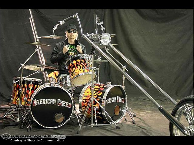 The drummer for the band American Greed has built a one-of-a-kind chopper drum set from real motorcycle parts. Description from drummer2drummer.com. I searched for this on bing.com/images