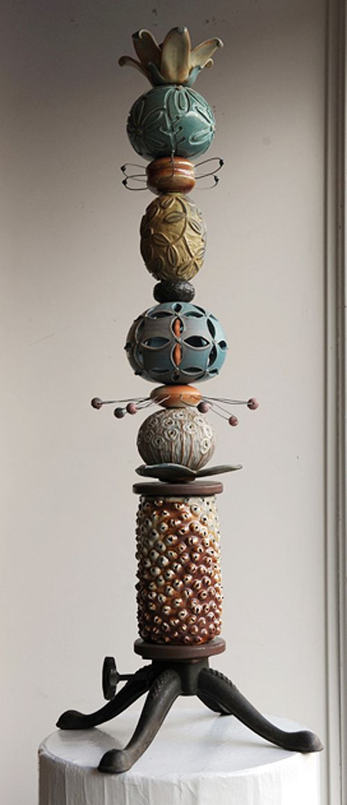 Hand-carved ceramic Totem with vintage flagpole base from the 1950's - $1,150