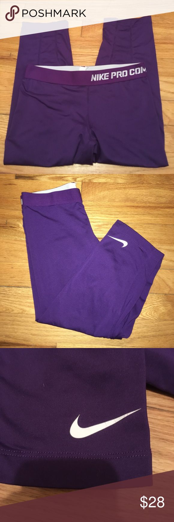 """Nike Pro Combat Dri Fit Purple Cropped Leggings Inseam:17.5"""". Good used condition with slight cracking on the Nike logo. Stretchy and flattering. Comes from a smoke free home Nike Pants Leggings"""