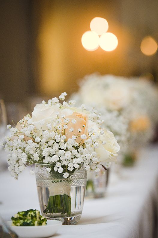 what about small bunches of flowers 3 vases per table of roses baby breath with 3 candle votives k kaproth wedding pinterest