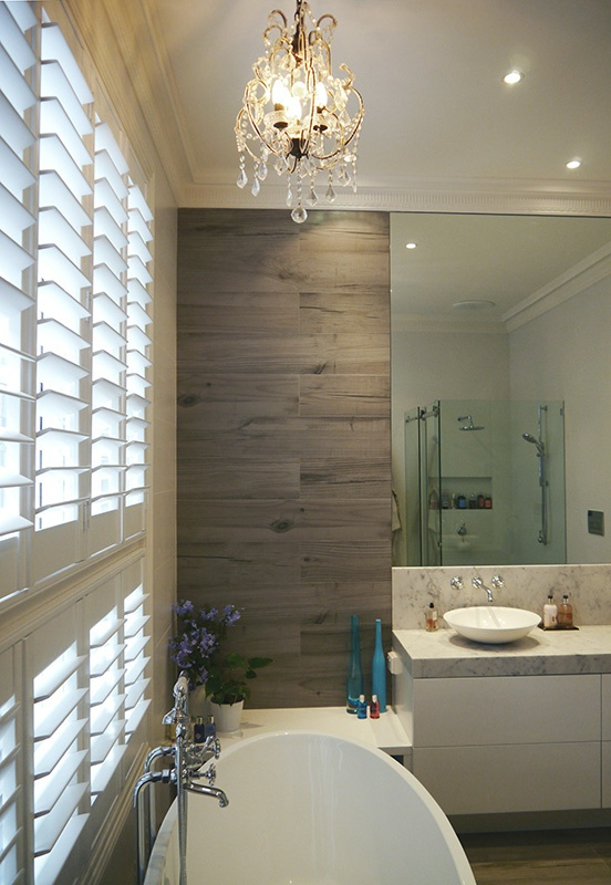 eat.bathe.live :: bathroom designed by eat.bathe.live with timber tiles and chandelier