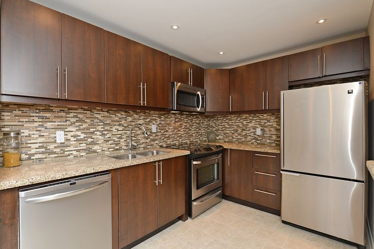 My client did such a great job renovating his townhouse...just look at this great kitchen...and it's listed under $300,000 inBrampton.