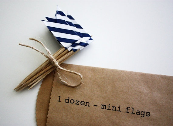 cupcake flags. i included these in a baking kit gift. so fun to make! i used security envelope paper (yup, shredded open my bank statement and bill envelopes... they have great little designs). double sided tape.