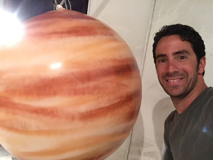 Spray paint balloons to look like planets! Use water based spray paint after the balloon is inflated. The paint peels when the balloon is deflated just fyi. Created by Matthew McAvene