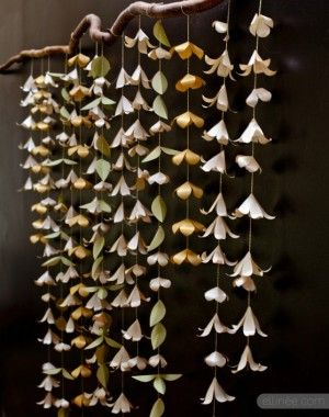 Paper flower backdrop garland from Ellinee Journal