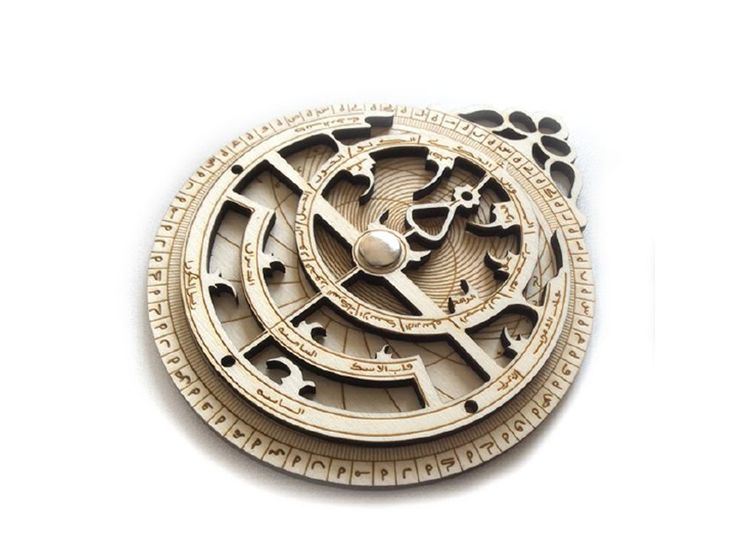 Persian astrolabe in wood with laser cut printing.