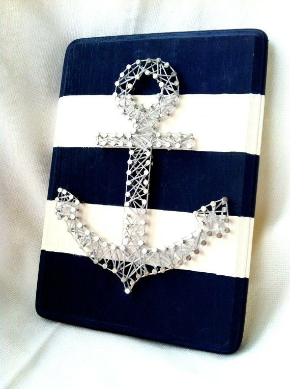 Gold anchor on blue and white