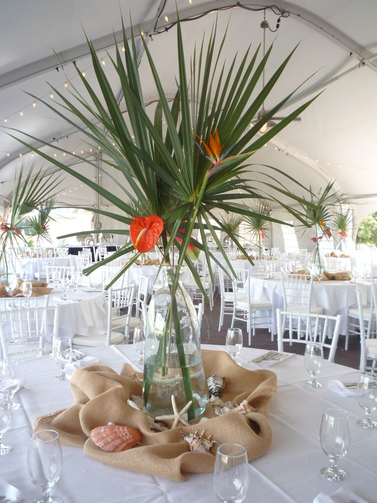 Tropical Theme! Island details can provide the vases, burlap, sea shells, and star fish for your reception!