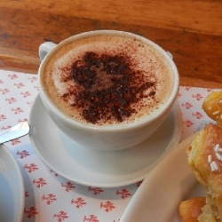 Cappuccino - meaning a coffee with steamed milk espresso and  sugar. Usually made for breakfast or a mid-afternoon snack