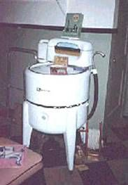 My grandma used one of these until almost 1970.  I loved to sit on the cellar steps and watch her run the sudsy clothes through the ringer.