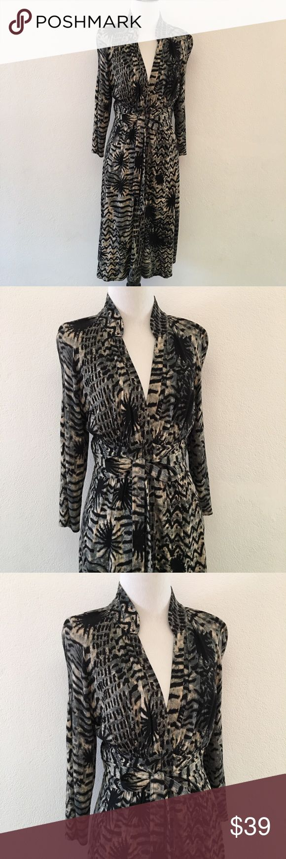 """Tracy Reese Animal Print Long Sleeve Dress size 4 Pre-owned authentic Tracy Reese Animal Print Long Sleeve Dress size 4. Armpit to armpit is 14"""" inches. Waist is 13"""" inches laying flat. Collar to hem is 42"""" inches. Shoulder to cuff is 18"""" inches. Dress has a front zipper and a belt that ties in front. Great structure. Please look at pictures for better reference. Happy Shopping! Tracy Reese Dresses Long Sleeve"""
