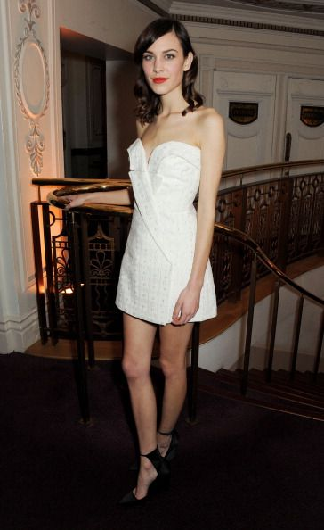Alexa Chung poses at the British Fashion Awards 2013 at London coliseum