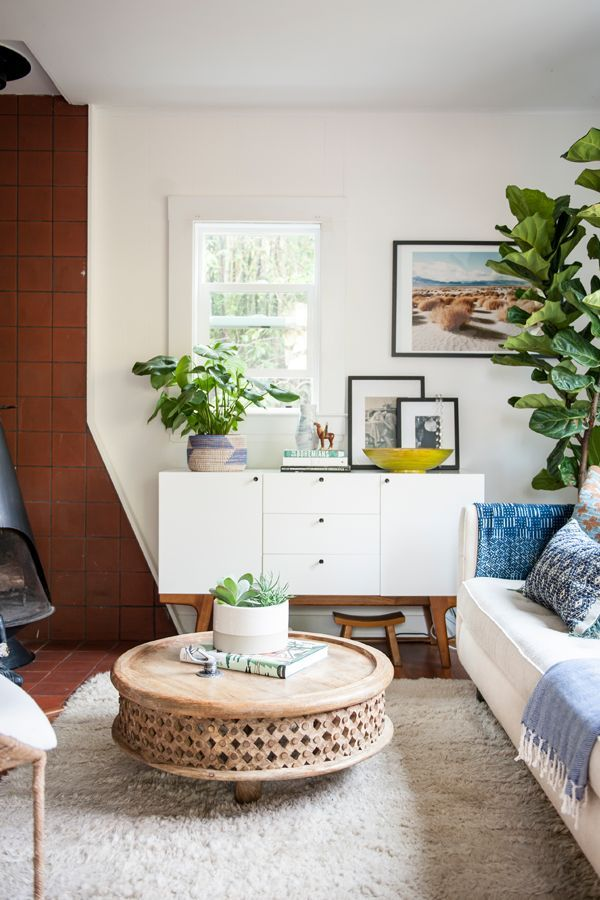 Mid-Century Modern living room with a boho twist. Home Tour - Ashley Redmond - The Tiny Treehouse - Interior Designer — via http://HouseOfHipsters.com