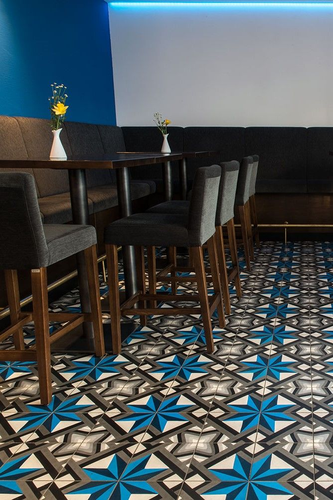 Restaurant Flooring With Blue And Grey Cement Tile With Geometric