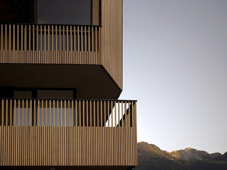 OFIS Architects  shopping roof apartments . bohinjska bistrica