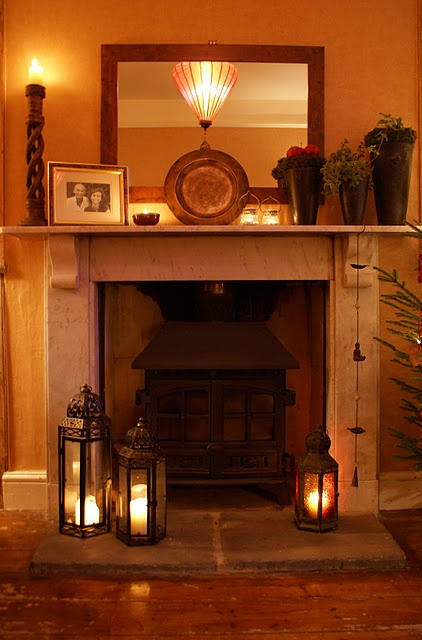 Love the lanterns by the fireplace.
