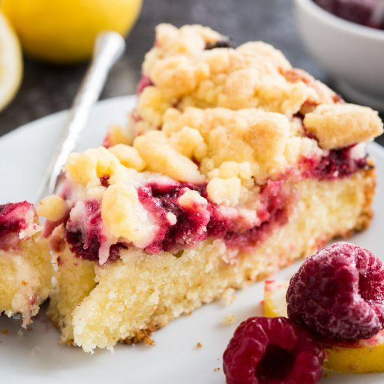 This easy Lemon Raspberry Cake is topped with delicious streusel and filled with juicy raspberries!