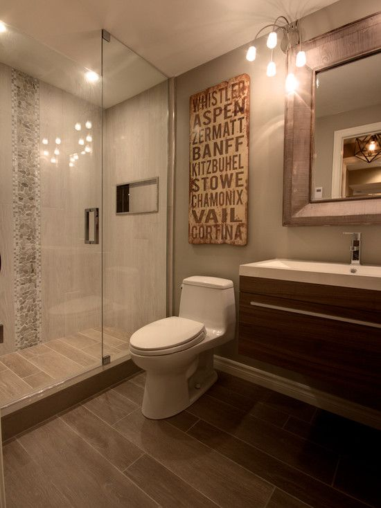 Continue floor tile into shower (curbless) with white tile surround (modern)  Carry floor tile up niche wall (column-like)