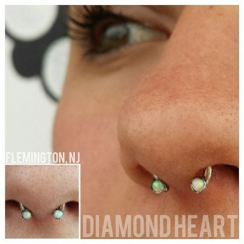 septum with an Anatometal circular barbell with forward facing threaded holes with white opals