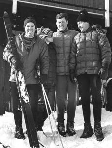 FILE - In this Dec. 31, 1966 file photo, Waterville Valley ski area developer Tom Corcoran, far left, and his wife Roberta, pose with Sen. Edward Kennedy, D-Mass., and Paul Pfosi, far right, a Swiss skier who headed the ski school at Waterville Valley, N.H. Corcoran, an Olympic skier who founded New Hampshire's Waterville Valley ski area and built it into a destination for racers and celebrities alike, died Tuesday, June 27, 2017. He was 85. (AP Photo)