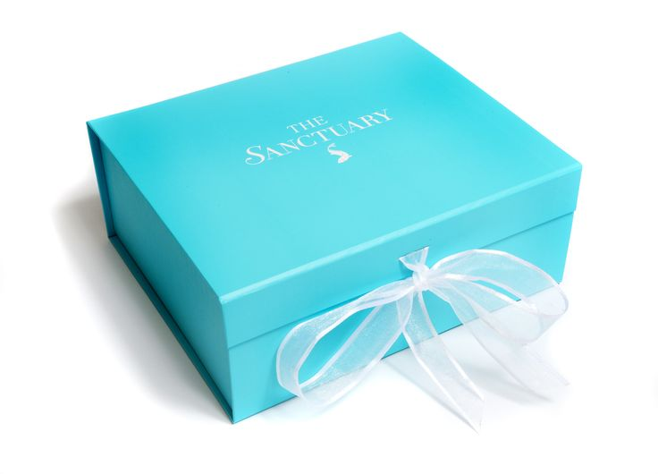 Turquoise folding gift box with white logo and organza ribbon. Manufactured by Foldabox.