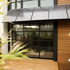 solar panel canopy - this might be a possibility over windows instead of awnings. -CAB