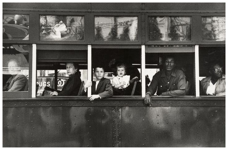 """Trolley - New Orleans"", by Robert Frank. This photo is part of a series called ""The Americans"". Everyone in this picture has a different facial expression and seems to be on a different journey."