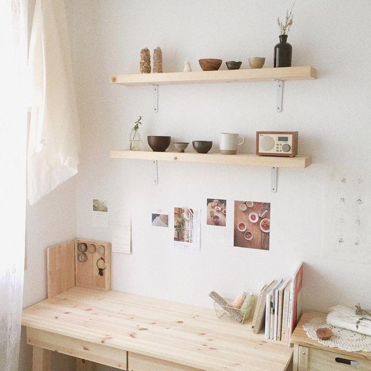 light wood furniture, white walls