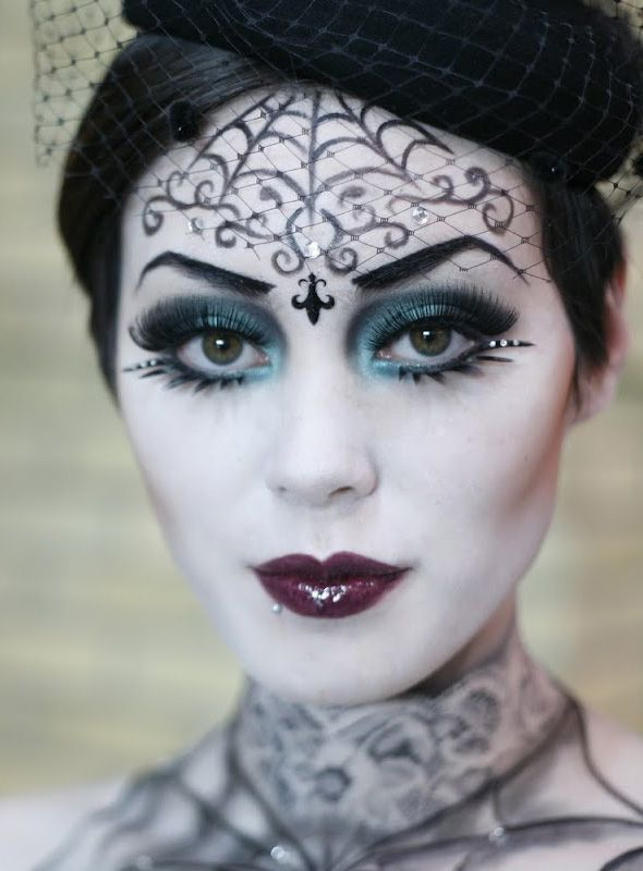 Great eyes on this Goth girl and check-out the web tattoo on her neck