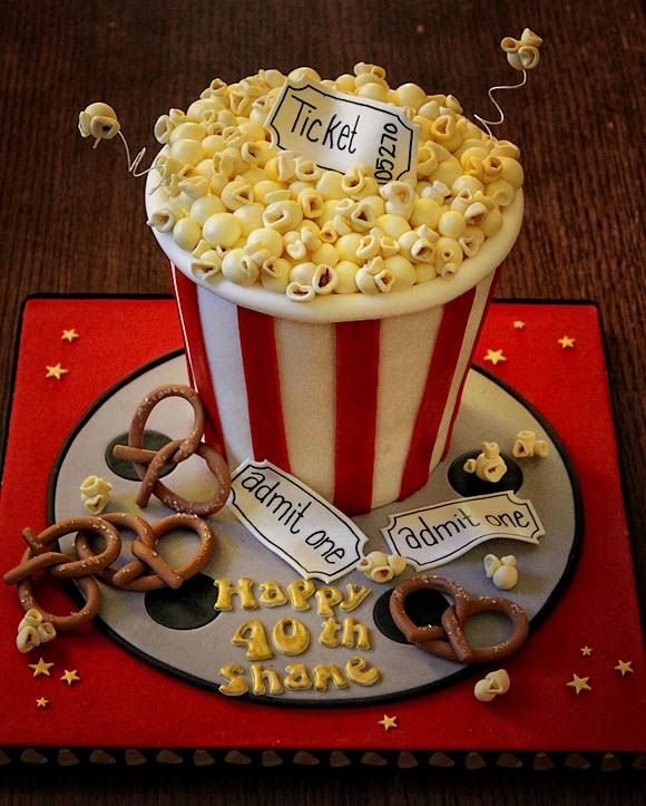 Night at the movies cake...for Josh, maybe with movie reel standing up since he doesn't like popcorn