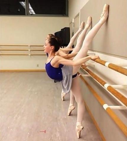 Arabesque stretching.