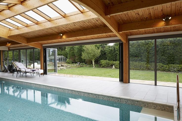 Origin bi-folding doors installed in a beautiful swimming pool extension