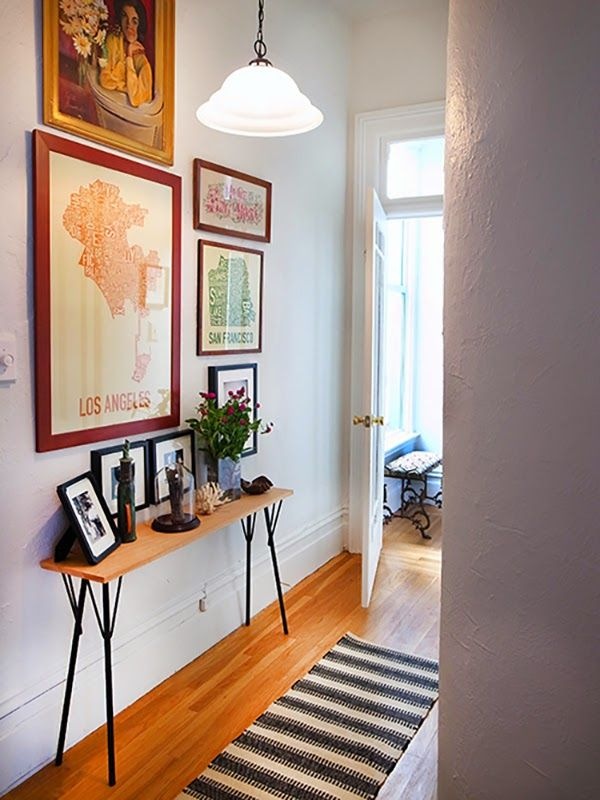 skinny console table and art wall narrow entryway