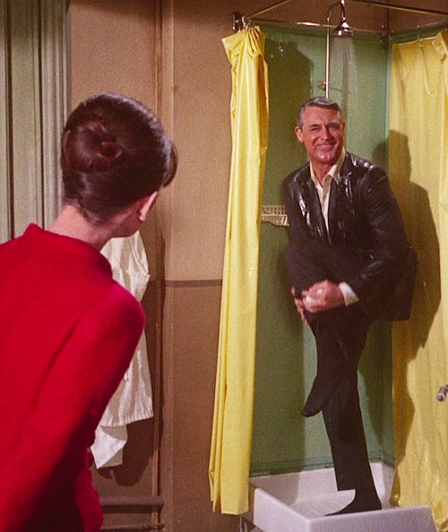 Cary Grant and Audrey Hepburn in Charade, 1963.  /  It was agreed that Cary Grant would not remove his shirt in the shower scene since he was nearly sixty and slightly overweight.