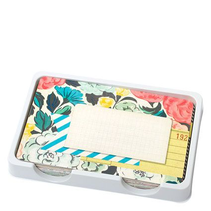 The Maggie Holmes Styleboard Mini Kit pairs muted yellows, blues, pinks and greens with whites and kraft colors.