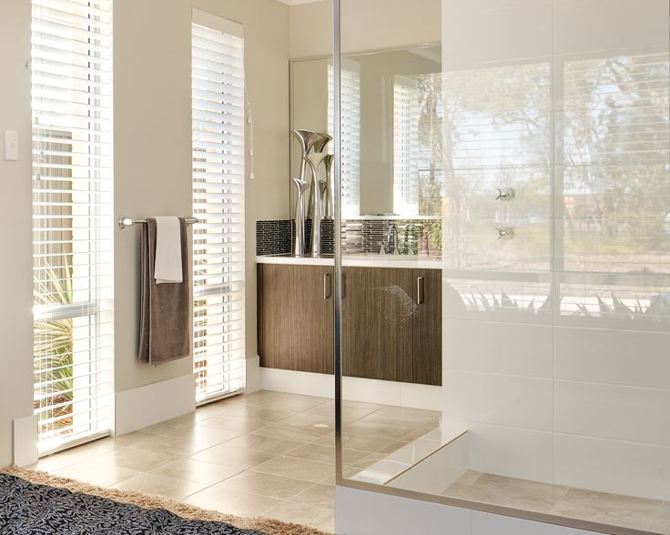 Laminex Domain Nuance cabinet doors offset by Laminex Polar White Diamond Gloss bench tops. Stylish modern ensuite with direct access to private master. On display in Brabham, Perth WA.