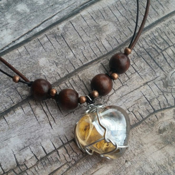 Look good in leather  homemade leather necklace with wooden beads and a heart-shaped glass pendant ☺