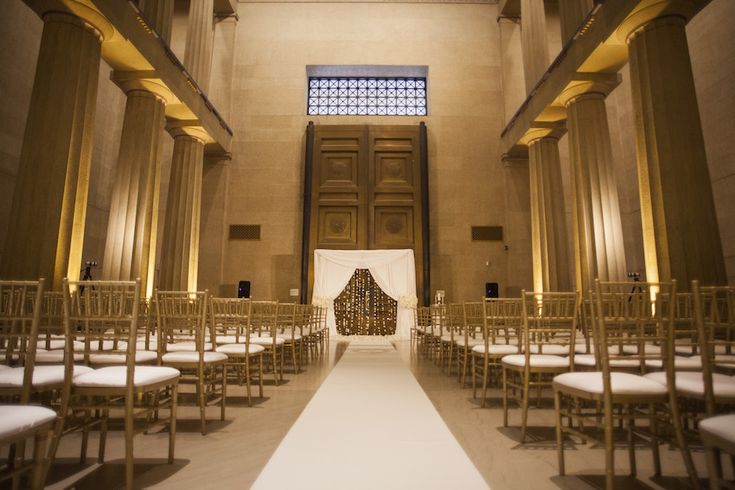 NFL Tennessee Titans player Jason McCourty's wedding ceremony was held in a great hall of The Parthenon museum and framed by towering columns. #weddingceremony #gold Photography: McLellan Style Read More: http://www.insideweddings.com/weddings/nfl-tennessee-titans-players-gold-white-wedding-in-nashville-tn/652/