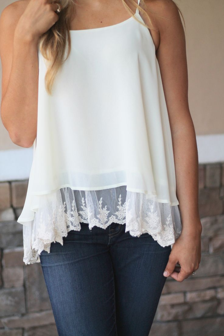 Gorgeous spaghetti strap tank with precious lace lining. You will find yourself wearing this cutie time and time again this spring. We love the simplicity of this tank that makes it so chic. Fits true