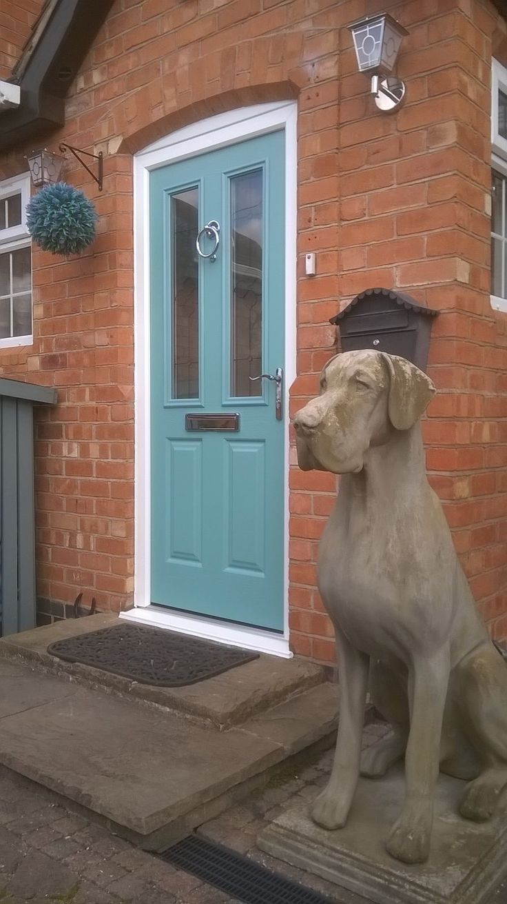 We're not sure what we love more... the dog statue or our lovely Endurance composite door. Design your dream Endurance door here; http://design.endurancedoors.co.uk/