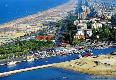 Rimini...it's the Ibiza of Italy and the beaches remind me of how beaches are in Cuba