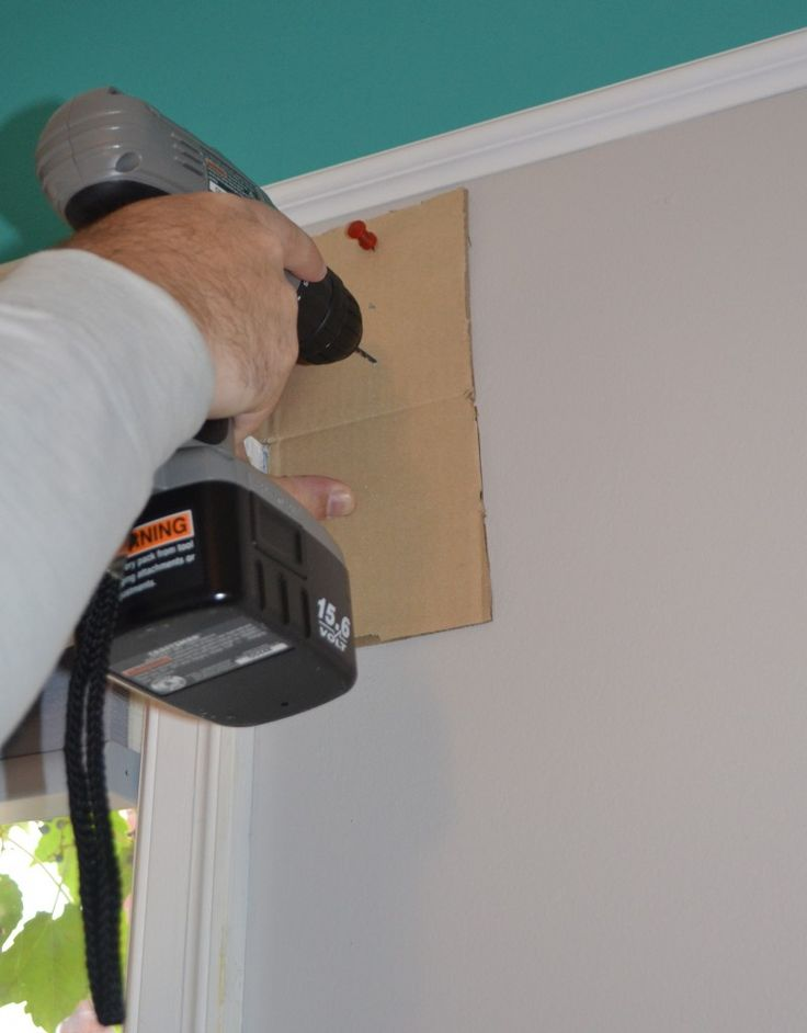 Use a cardboard cut out to hang curtains! Create L-shape out of cardboard, pin to wall, hold hardware up and mark where to drill.  Then you just drill through the cardboard.  Once you have the template you just flip it over for the other side of the window and any other windows.