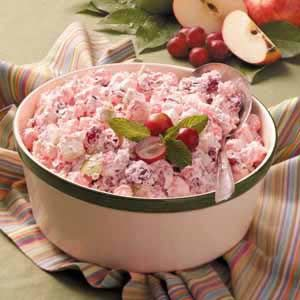 Creamy Cranberry Apple Salad Recipe  •1 package (12 ounces) fresh or frozen cranberries, thawed  •3 cups miniature marshmallows  •1 cup sugar  •2 medium apples, diced  •1/2 cup halved seedless red grapes  •1/2 cup chopped walnuts  •1/4 teaspoon salt  •1 carton (8 ounces) frozen whipped topping, thawed