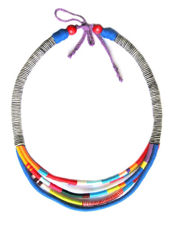Tribal Multi Strand Rope African necklace. The necklace comprises five hand wrapped cotton ropes in color block african style. Cord side is made